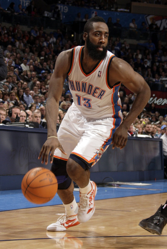 Photo - Oklahoma City's James Harden (13) dribbles up court during the NBA basketball game between the Oklahoma City Thunder and the Denver Nuggets at the Chesapeake Energy Arena, Sunday, Feb. 19, 2012. Photo by Sarah Phipps, The Oklahoman