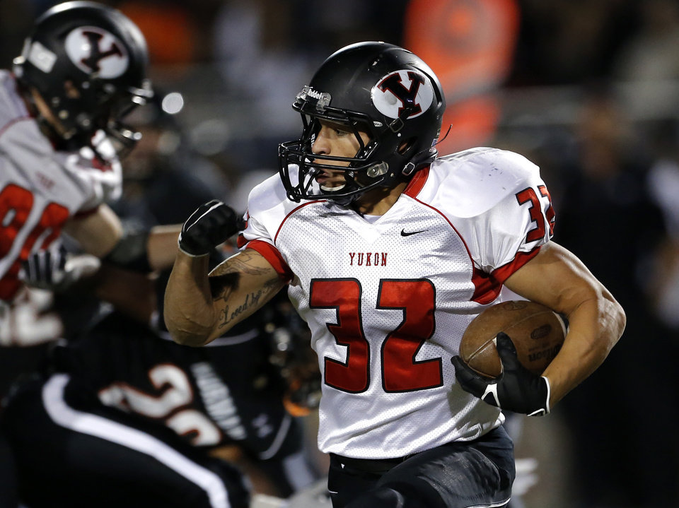 Photo - Yukon's A.J. West rushes during the high school football game between Norman and Yukon at Norman High School in Norman, Okla., Thursday, Nov. 8, 2012. Photo by Sarah Phipps, The Oklahoman