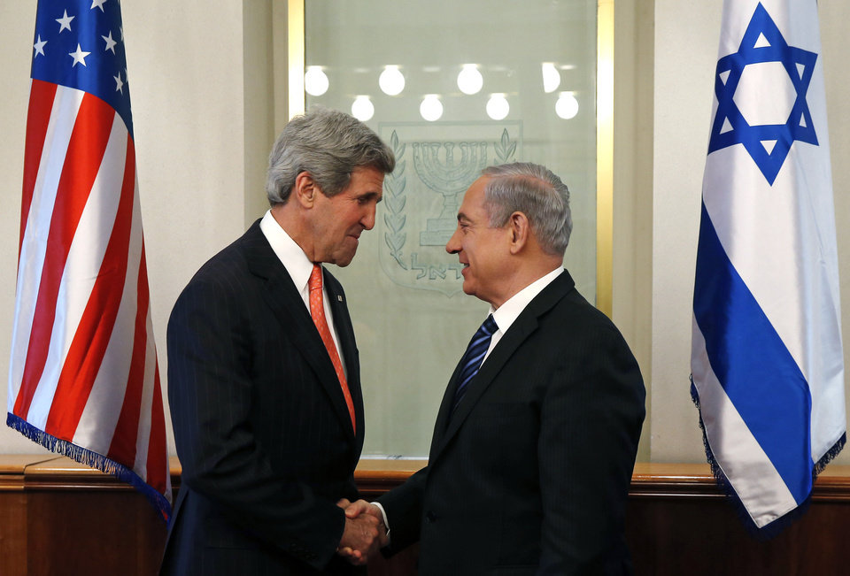 Photo - U.S. Secretary of State John Kerry, left, meets with Israeli Prime Minster Benjamin Netanyahu in Jerusalem Thursday, May 23, 2013. The United States and Israel are raising hopes for a restart of the Middle East peace process after more than four years of hardly any talks. (AP Photo/Jim Young, Pool)