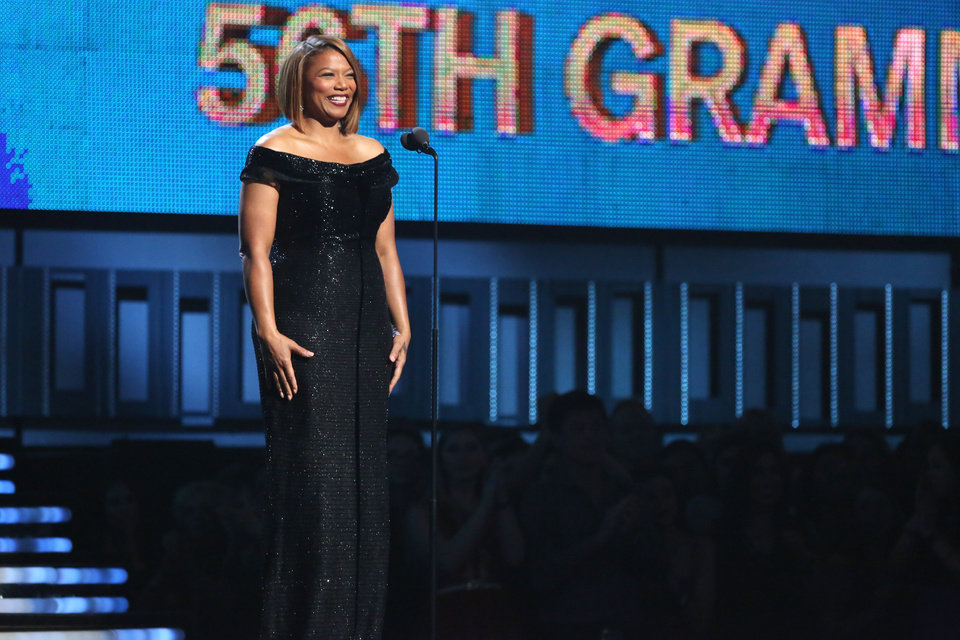 """Photo - Queen Latifah introduces a performance of """"Same Love"""" by Macklemore Ryan Lewis, with Mary Lambert, Trombone Shorty and Madonna at the 56th annual Grammy Awards at Staples Center on Sunday, Jan. 26, 2014, in Los Angeles. (Photo by Matt Sayles/Invision/AP)"""