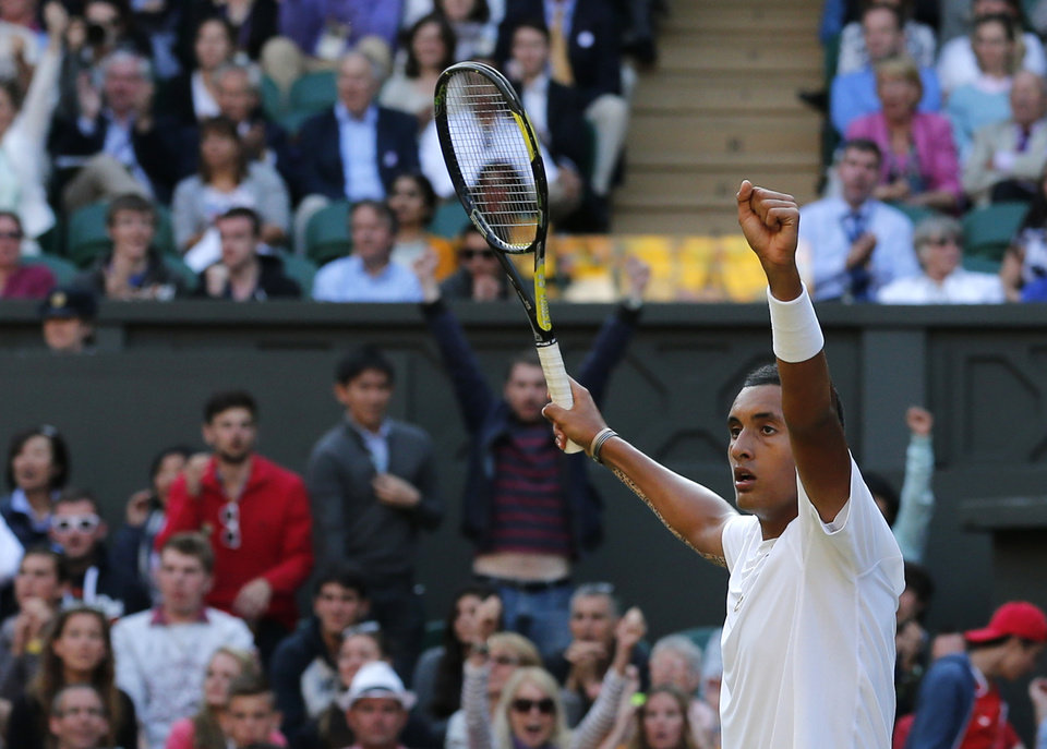 Photo - Nick Kyrgios of Australia celebrates after winning the third set against Rafael Nadal of Spain during their men's singles match on Centre Court at the All England Lawn Tennis Championships in Wimbledon, London, Tuesday, July 1, 2014. (AP Photo/Ben Curtis)