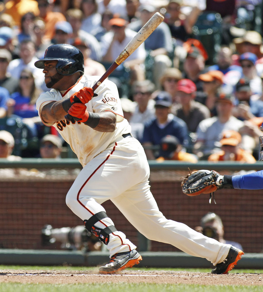 Photo - San Francisco Giants' Pablo Sandoval watches his RBI single against the Chicago Cubs during the sixth inning of a baseball game, Wednesday, May 28, 2014, in San Francisco. (AP Photo/George Nikitin)