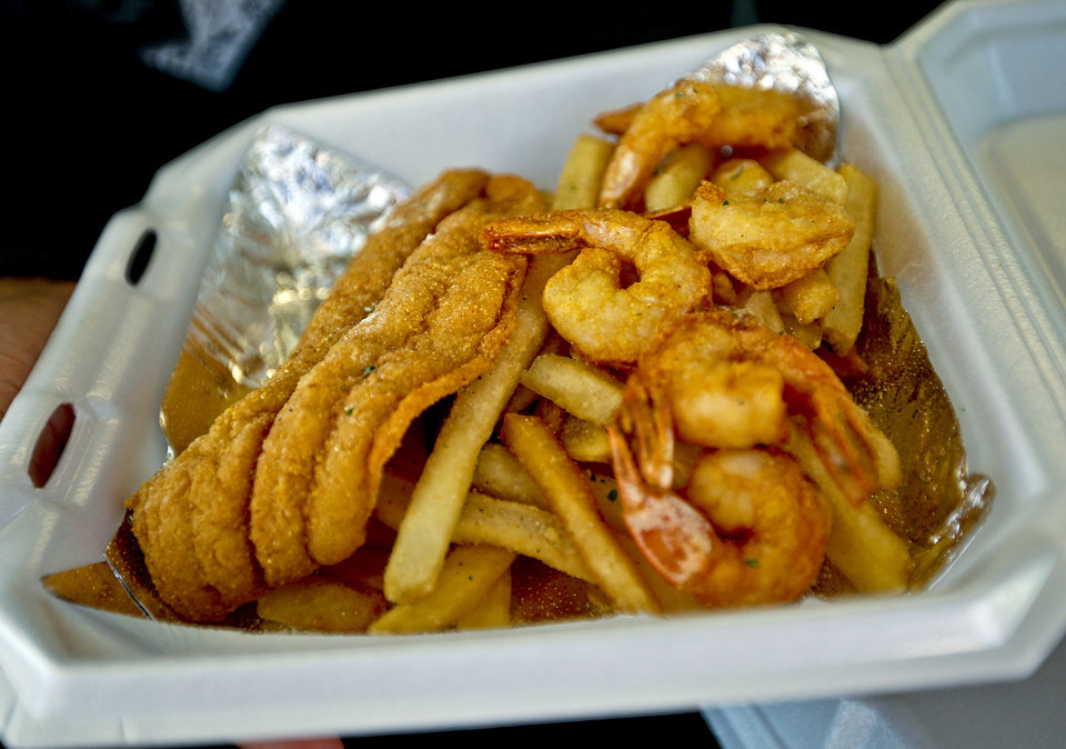 Photo - The fish and shrimp basket from Off the Hook food truck at Dunlap Codding on Film Row in Oklahoma City, Okla., Wednesday, Dec. 18, 2013.  Dunlap Codding will turn Film Row into a winter market on Friday with crafts vendors, food trucks, drinks and live music. About 40 vendors plan to sell their wares at the event.Photo by Chris Landsberger, The Oklahoman