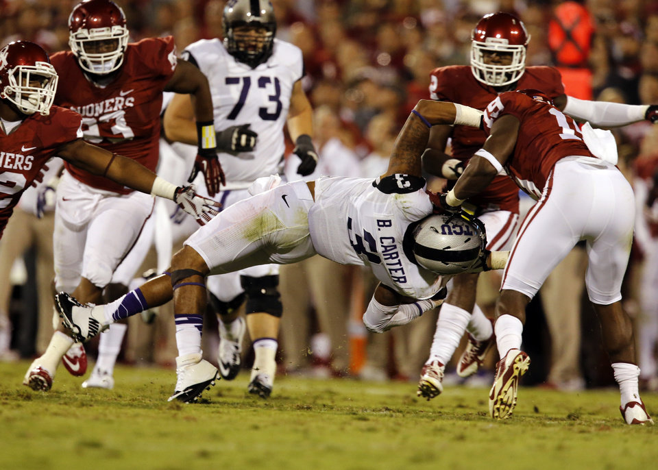 Oklahoma\'s Eric Striker (19) is called for a face mask violation as he brings down TCU\'s Brandon Carter (3) during the second half of a college football game between the University of Oklahoma Sooners (OU) and the TCU Horned Frogs at Gaylord Family-Oklahoma Memorial Stadium in Norman, Okla., on Saturday, Oct. 5, 2013. Photo by Steve Sisney, The Oklahoman