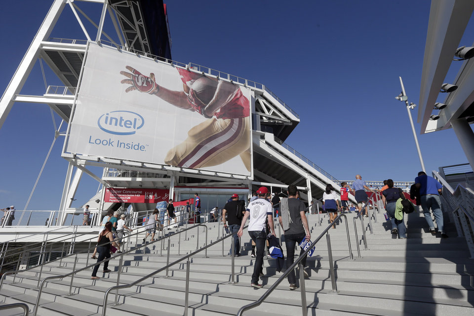 Photo - Fans enter the new Levi's Stadium before an MLS soccer match between the San Jose Earthquakes and the Seattle Sounders on Saturday, Aug. 2, 2014, in Santa Clara, Calif. (AP Photo/Marcio Jose Sanchez)