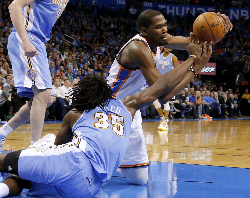 Oklahoma City\'s Kevin Durant (35) and Denver\'s Kenneth Faried (35) fight for a loose ball during an NBA basketball game between the Oklahoma City Thunder and the Denver Nuggets at Chesapeake Energy Arena in Oklahoma City, Tuesday, March 19, 2013. Denver won 114-104. Photo by Bryan Terry, The Oklahoman