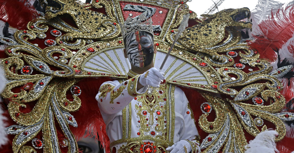 Photo - Garren Thomas Mims Sr., King of the Krewe of Zulu, rides his float during Mardi Gras day in New Orleans, Tuesday, March 4, 2014. The Zulu parade began on schedule, led by a New Orleans police vanguard on horseback that included Mayor Mitch Landrieu. (AP Photo/Gerald Herbert)