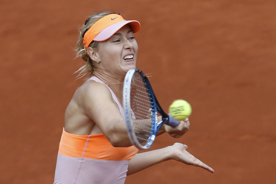 Photo - Russia's Maria Sharapova returns the ball during the third round match of the French Open tennis tournament against Argentina's Paula Ormaechea at the Roland Garros stadium, in Paris, France, Friday, May 30, 2014. Sharapova won in two sets 6-0, 6-0. (AP Photo/Darko Vojinovic)