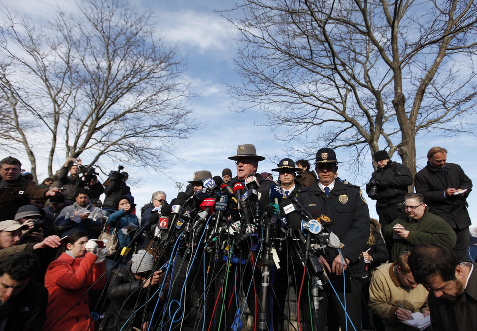Photo - Lt. J. Paul Vance of the Connecticut State Police conducts a news briefing, Saturday, Dec. 15, 2012 in Newtown, Conn. The massacre of 26 children and adults at Sandy Hook Elementary school elicited horror and soul-searching around the world even as it raised more basic questions about why the gunman, 20-year-old Adam Lanza, would have been driven to such a crime and how he chose his victims. (AP Photo/Jason DeCrow)