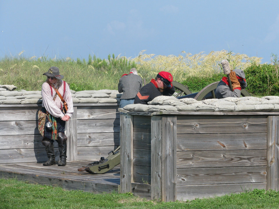 Photo -  Re-enactors fire a cannon outside Fort Morgan. Photo by Peter Wright, for The Oklahoman