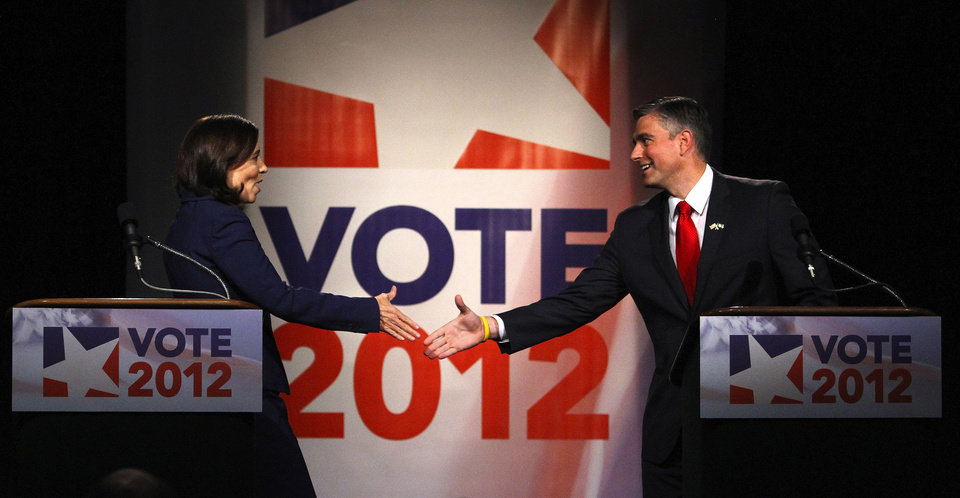 Democratic U.S. Sen. Maria Cantwell, left, shakes hands with her Republican challenger, Washington State Sen. Michael Baumgartner, after their debate at the KCTS television studios on Friday, Oct. 12, 2012, Seattle. (AP Photo/The Seattle Times, John Lok) MAGS OUT; NO SALES; SEATTLEPI.COM OUT; MANDATORY CREDIT