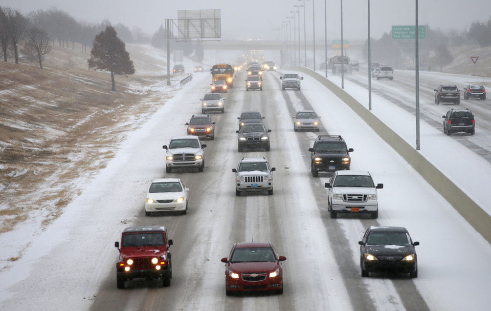 Traffic moves along the Kilpatrick Turnpike near May Ave. in Oklahoma City during a winter storm, Thursday, December, 5, 2013. Photo by Bryan Terry, The Oklahoman