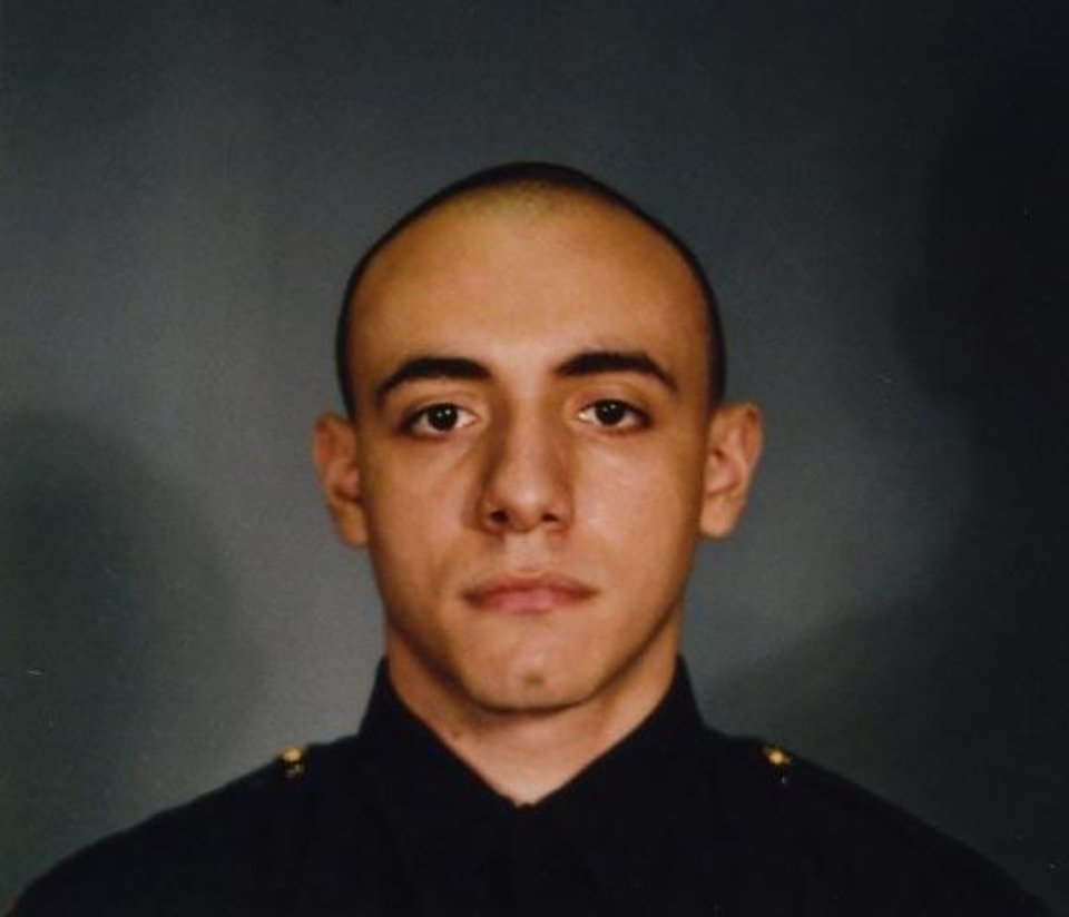 Photo - This photo provided by the Jersey City Mayor's office shows Officer Melvin Santiago.  Santiago was shot in the head while still in his police vehicle as he and his partner responded to an armed robbery call at a Walgreens Pharmacy at about 4.a.m., Jersey City Mayor Steven Fulop said in a statement. Fulop says Santiago was pronounced dead at Jersey City Medical Center. No other details about the officer were immediately released.  Fulop said officers responding to the robbery call shot and killed the man who shot Santiago. He was not immediately identified. (AP Photo/Jersey City Mayor's office)