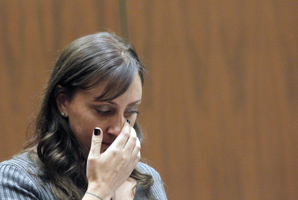 Photo - Evin Collins, sister of beating victim Bryan Stow is shown during a hearing Thursday Feb. 20, 2014 in Los Angeles. Two men, Marvin Norwood, and Louie Sanchez  pleaded guilty Thursday to a 2011 beating at Dodger Stadium that left San Francisco Giants fan Stow brain damaged and disabled. The pair were  immediately sentenced by an angry judge who called them cowards and the sort of people that sports fans fear when they go to games.(AP Photo/Nick Ut )