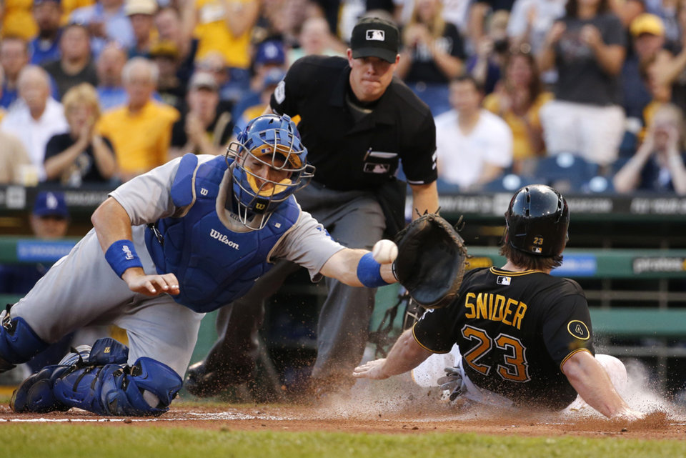 Photo - Pittsburgh Pirates' Travis Snider (23) scores as the ball arrives late ahead of the tag by Los Angeles Dodgers catcher A.J. Ellis on a double by Pirates' Neil Walker off Dodgers starting pitcher Josh Beckett during the third inning of a baseball game in Pittsburgh Tuesday, July 22, 2014. (AP Photo)