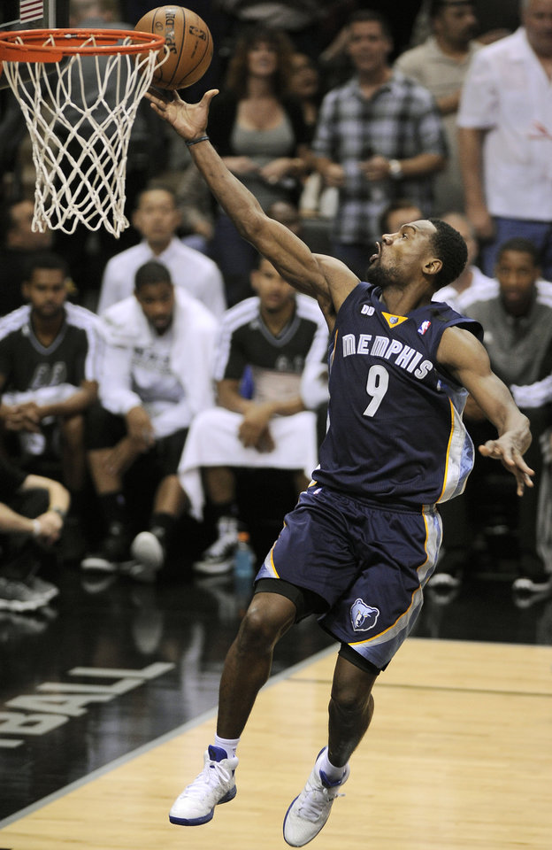Photo - Memphis Grizzlies' Tony Allen scores during the second half of Game 1 of the Western Conference final NBA basketball playoff series against the San Antonio Spurs Sunday, May 19, 2013, in San Antonio. San Antonio won 105-83. (AP Photo/Darren Abate)