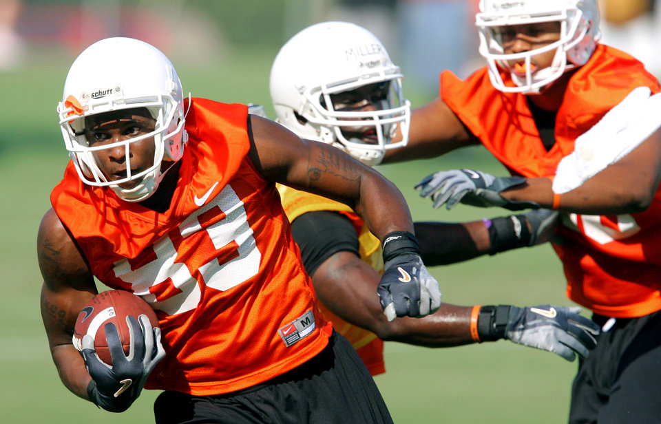 Photo - Wide receiver Artrell Woods runs upfield after making a catch during the first Oklahoma State University fall football practice, in Stillwater, Okla., Thursday, July 31, 2008. BY MATT STRASEN, THE OKLAHOMAN