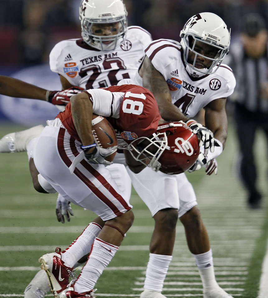 Texas A&M\'s Toney Hurd Jr. (4) forces Oklahoma\'s Jalen Saunders (18) out of bounds during the college football Cotton Bowl game between the University of Oklahoma Sooners (OU) and Texas A&M University Aggies (TXAM) at Cowboy\'s Stadium on Friday Jan. 4, 2013, in Arlington, Tx. Photo by Chris Landsberger, The Oklahoman