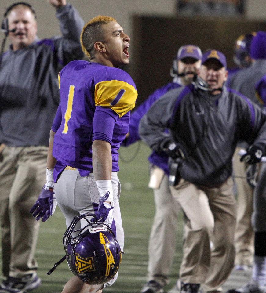 Anadarko\'s Sheldon Wilson reacts after scoring a touchdown during the Class 3A high school football state championship game between Cascia Hall and Anadarko at Boone Pickens Stadium in Stillwater, Friday, Dec. 9, 2011. Photo by Bryan Terry, The Oklahoman