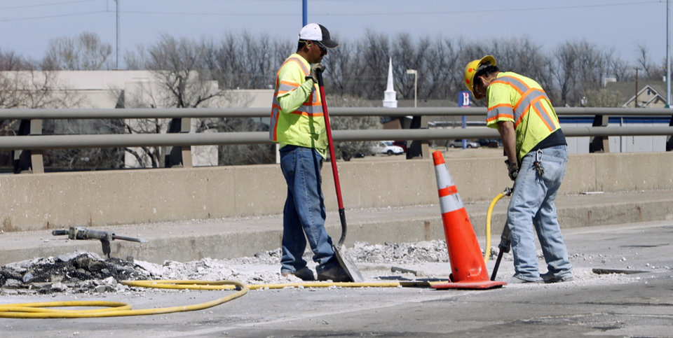 Workers repair a deteriorating section of the Lindsey Street bridge at Interstate 35 in Norman. PHOTO BY STEVE SISNEY, THE OKLAHOMAN <strong>STEVE SISNEY</strong>