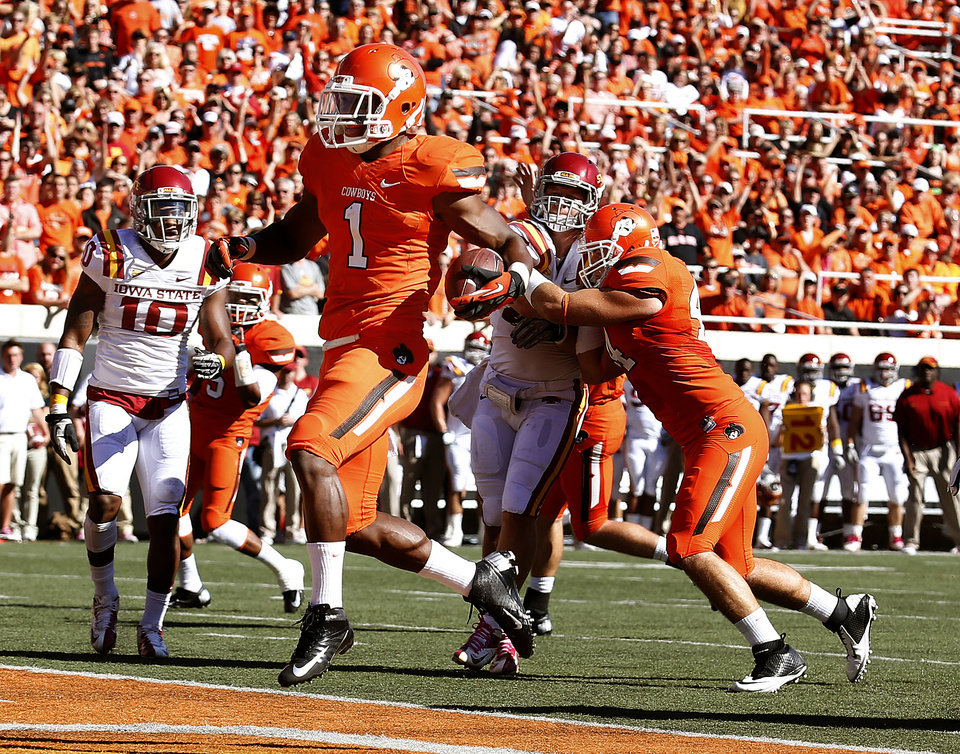 Photo - Oklahoma State's Joseph Randle (1) scores a touchdown in the first quarter of a college football game between Oklahoma State University (OSU) and Iowa State University (ISU) at Boone Pickens Stadium in Stillwater, Okla., Saturday, Oct. 20, 2012. Photo by Sarah Phipps, The Oklahoman