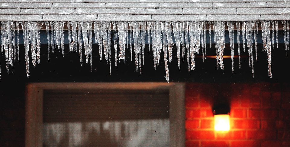 Photo - Icicles are shown Thursday on the front of a house in the 2200 block of Downing in The Village.  Photo by Jim Beckel, The Oklahoman