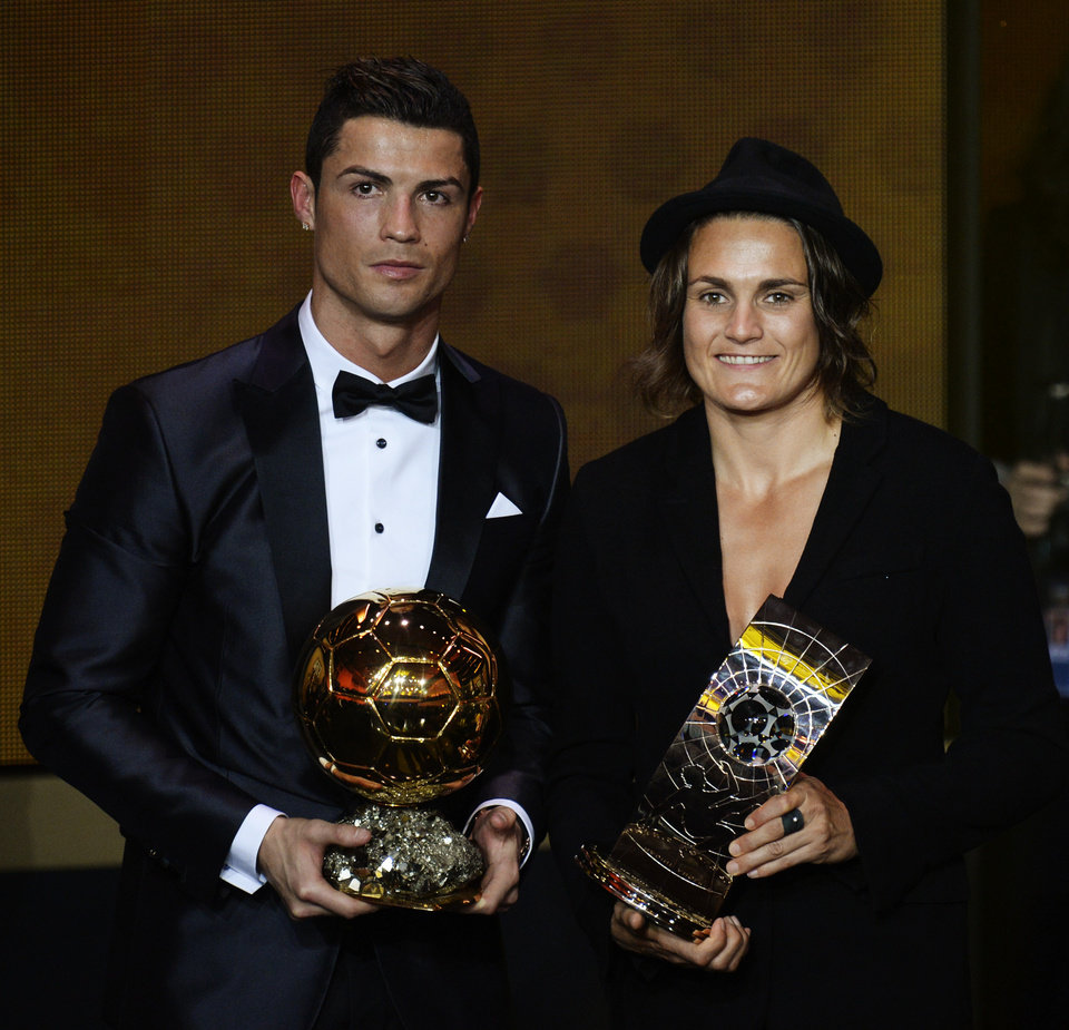 Photo - Cristiano Ronaldo of Portugal, left, and Nadine Angerer of Germany pose with their trophies after being elected FIFA Men's and Women's soccer player of the year 2013 at the FIFA Ballon d'Or 2013 gala at the Kongresshaus in Zurich, Switzerland, Monday, Jan. 13, 2014. (AP Photo/Keystone, Steffen Schmidt)