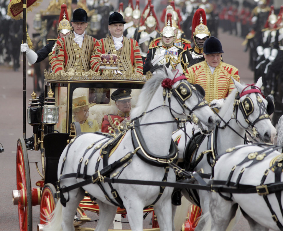 Photo - Britain's Queen Elizabeth II and Britain's Prince Philip make their way down the Mall to Buckingham Palace after the Royal Wedding in London Friday, April, 29, 2011. (AP Photo/Lefteris Pitarakis) ORG XMIT: RWMG173