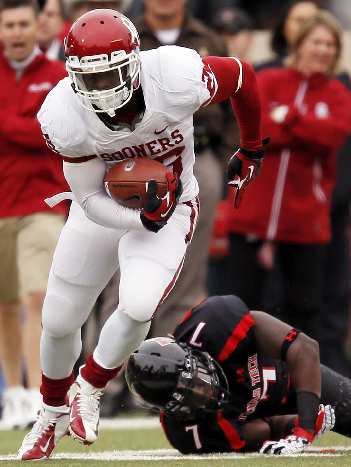 Oklahoma's Damien Williams (26) leaves behind Texas Tech's Will Smith (7) during a college football game between the University of Oklahoma (OU) and Texas Tech University at Jones AT&T Stadium in Lubbock, Texas, Saturday, Oct. 6, 2012. OU won, 41-20. Photo by Nate Billings, The Oklahoman
