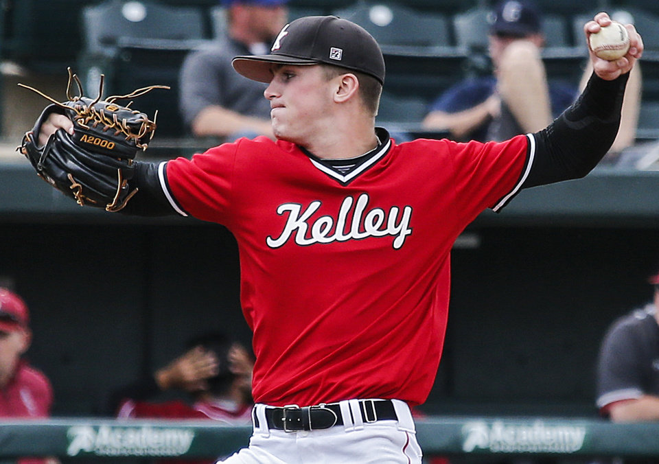 Photo - Bishop Kelley's Josh Limes (8) throws a pitch during the Class 6A baseball state tournament game between Puntnam City North and Bishop Kelley at the University of Oklahoma in Norman, Okla. on Thursday, May 15, 2014.   Photo by Chris Landsberger, The Oklahoman