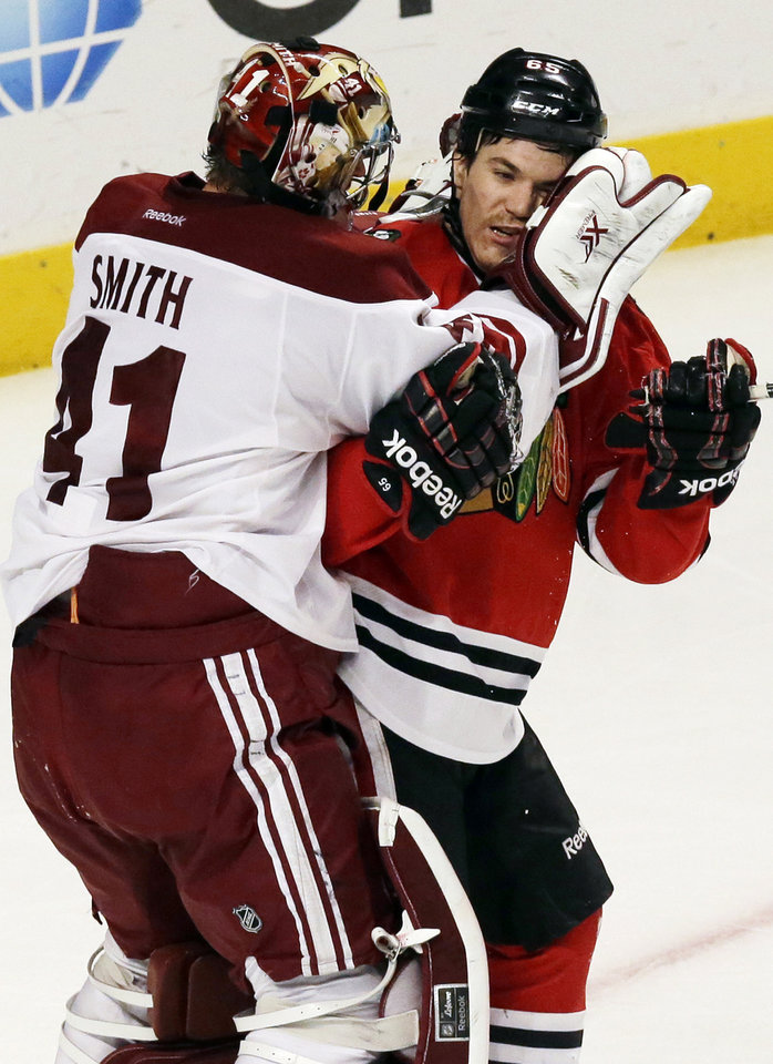 Phoenix Coyotes goalies Mike Smith, left, fights with Chicago Blackhawks' Andrew Shaw during the third period of an NHL hockey game in Chicago, Thursday, Nov. 14, 2013. The Blackhawks won 5-4. (AP Photo/Nam Y. Huh)