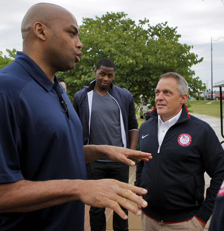 Photo - Charles Barkley, left, talks with Joe Jacobi, right, USA Canoe/Kayak CEO, as Desmond Mason looks on before taking a tour of the Devon Boathouse in Oklahoma City, Friday, June 1, 2012. Photo by Nate Billings, The Oklahoman