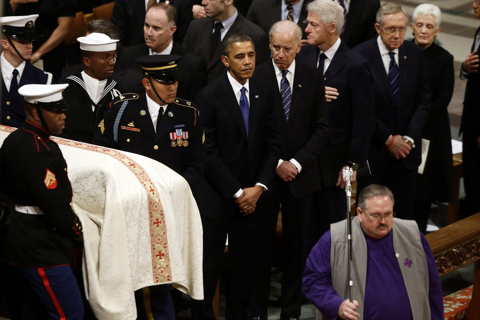 Photo - President Barack Obama, Vice President Joe Biden, former President Bill Clinton, and Senate Majority Leader Harry Reid of Nevada stand as the casket is brought in at the funeral service for the late Sen. Daniel Inouye, D-Hawaii, at the Washington National Cathedral, Friday, Dec. 21, 2012. (AP Photo/Charles Dharapak)