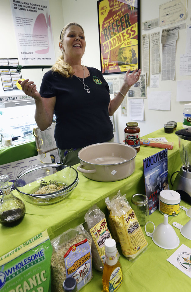 Photo - In this Thursday, July 10, 2014, photo,  Melissa Fitzgerald discusses how to prepare a cannabis-infused dipping sauce during a cooking class at the New England Grass Roots Institute in Quincy, Mass. Some pot users turn to edibles because they don't like to inhale or smell the smoke, or just want variety or a longer lasting, more intense high. (AP Photo/Michael Dwyer)