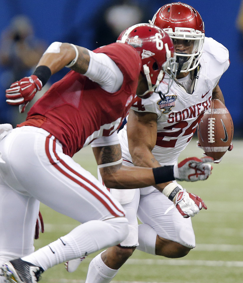 Photo - Oklahoma's Brennan Clay (24) looks for running room past Alabama's Ha Ha Clinton-Dix (6) during the NCAA football BCS Sugar Bowl game between the University of Oklahoma Sooners (OU) and the University of Alabama Crimson Tide (UA) at the Superdome in New Orleans, La., Thursday, Jan. 2, 2014.  .Photo by Chris Landsberger, The Oklahoman