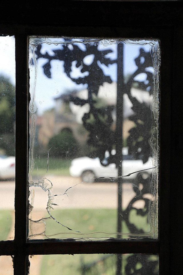 The bullet hole, protected by Plexiglas, that gives the Bullet Hole House its name and owners Dr. David Allen and Rosanna Tran a great mystery story to tell. Steve Gooch - The Oklahoman