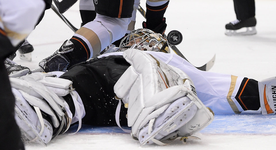 Photo - Anaheim Ducks goalie John Gibson stops a shot on goal during the second period in Game 4 of an NHL hockey second-round Stanley Cup playoff series against the Los Angeles Kings, Saturday, May 10, 2014, in Los Angeles. (AP Photo/Mark J. Terrill)