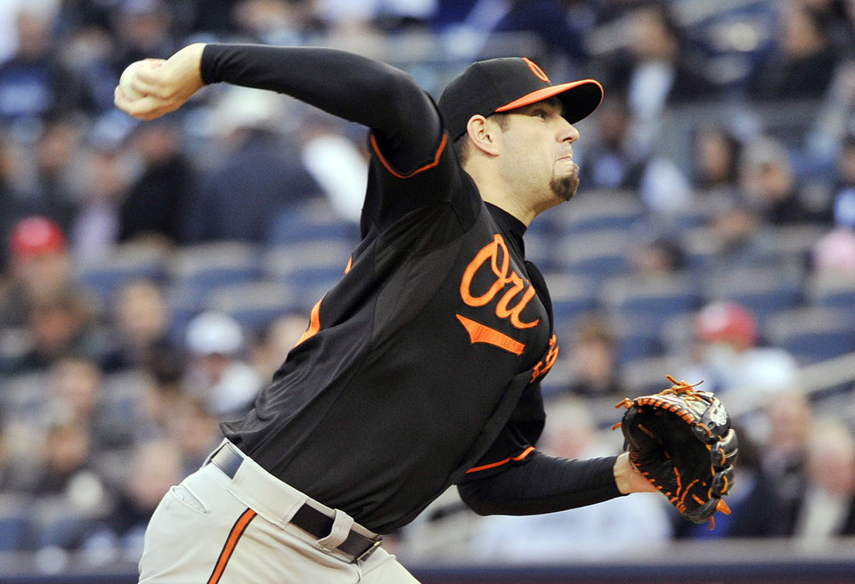 Photo -   Baltimore Orioles' Jason Hammel delivers a pitch during the first inning of Game 5 of the American League division baseball series against the New York Yankees, Friday, Oct. 12, 2012, in New York. (AP Photo/Bill Kostroun)