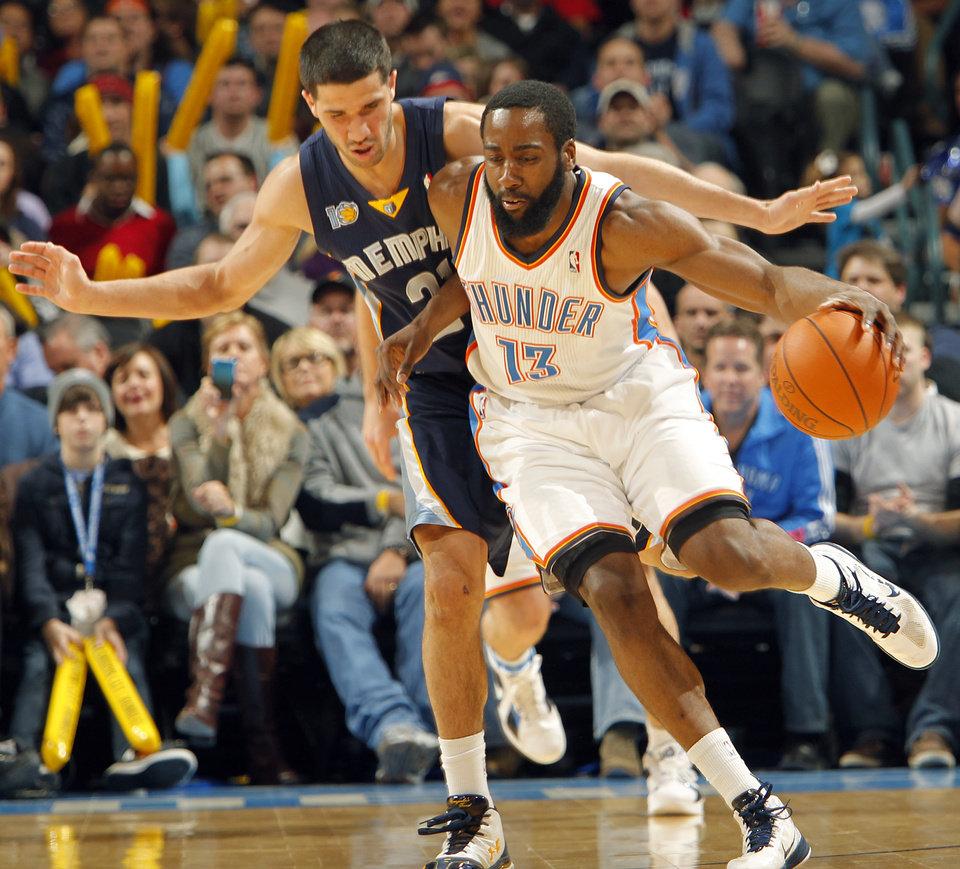 Photo - The Thunder's James Harden gets a steam on Memphis' Greivis Vasquez (21) during the NBA basketball game between the Oklahoma City Thunder and the Memphis Grizzlies at the Oklahoma City Arena on Tuesday, Feb. 8, 2011, Oklahoma City, Okla.  Photo by Chris Landsberger, The Oklahoman