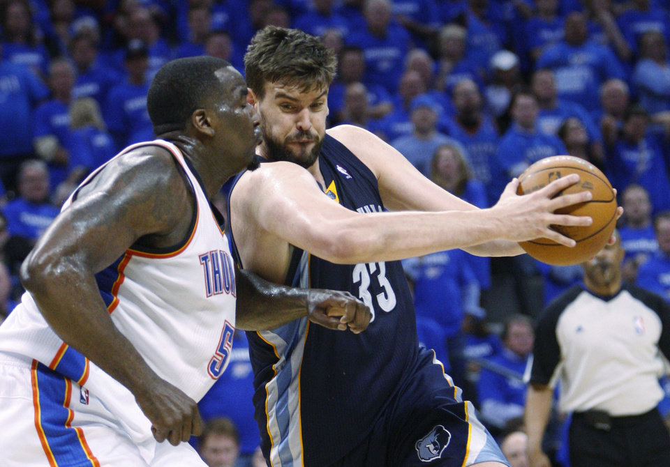 Photo - Memphis Grizzlies center Marc Gasol, right, of Spain, drives around Oklahoma City Thunder center Kendrick Perkins, left, in the fourth quarter of Game 2 of a second-round NBA basketball playoff series in Oklahoma City, Tuesday, May 3, 2011. Oklahoma City won 111-102. (AP Photo/Sue Ogrocki)