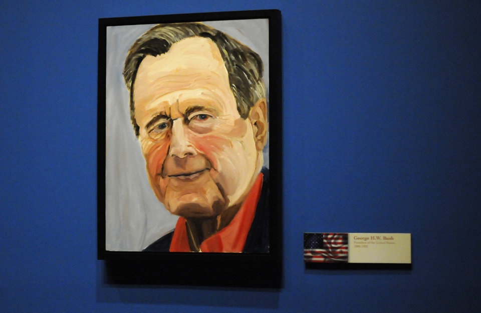 Photo - A portrait of former President George H.W. Bush painted by his son former President George W. Bush, which is part of the exhibit