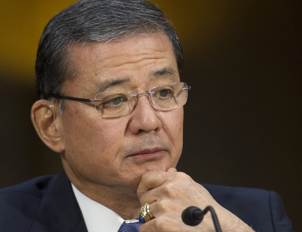 Photo - FILE - This May 15, 2014 file photo shows Veterans Affairs Secretary Eric Shinseki testifying on Capitol Hill in Washington. Veterans at the Phoenix veterans hospital waited on average 115 days for their first medical appointment _ 91 days longer than the hospital reported, the Veterans Affairs Department's inspector general said Wednesday. Rep. Jeff Miller, R-Fla., chairman of the House Veterans Affairs Committee, and Sen. John McCain, R-Ariz., immediately called for VA Secretary Eric Shinseki to resign. Miller also said Attorney General Eric Holder should launch a criminal investigation into the VA. (AP Photo/Cliff Owen, File)
