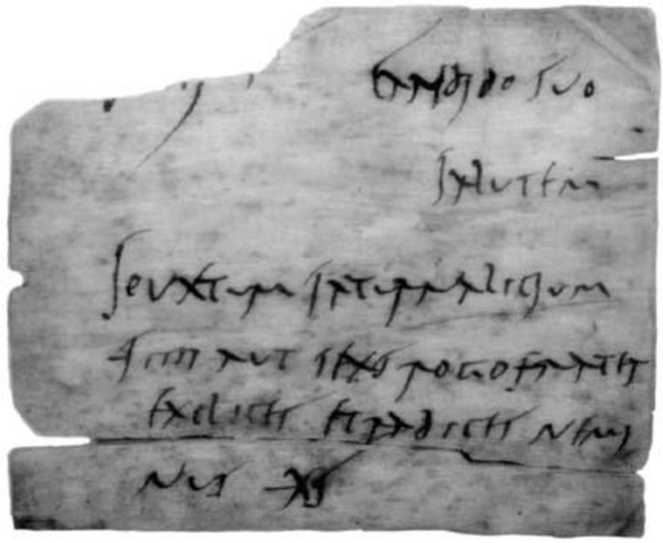 Photo -  A scrip for Oxycontin? No. Just text from one of the tablets. Roman cursive wasn't known for its legibility.