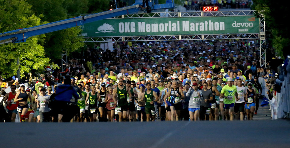 Photo - A second wave of runners start the  Oklahoma City Memorial Marathon in Oklahoma City, Sunday, April 28, 2019. [Sarah Phipps/The Oklahoman]