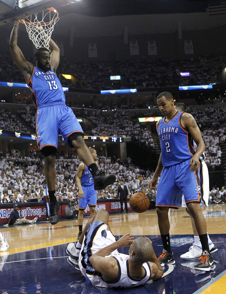Oklahoma City Thunder guard James Harden (13) tries to keep from landing on Memphis Grizzlies forward Shane Battier, bottom, after Harden dunked the ball during the first half of Game 6 of a second-round NBA basketball playoff series on Friday, May 13, 2011, in Memphis, Tenn. At right is Thunder guard Thabo Sefolosha (2), of Switzerland. (AP Photo/Lance Murphey)