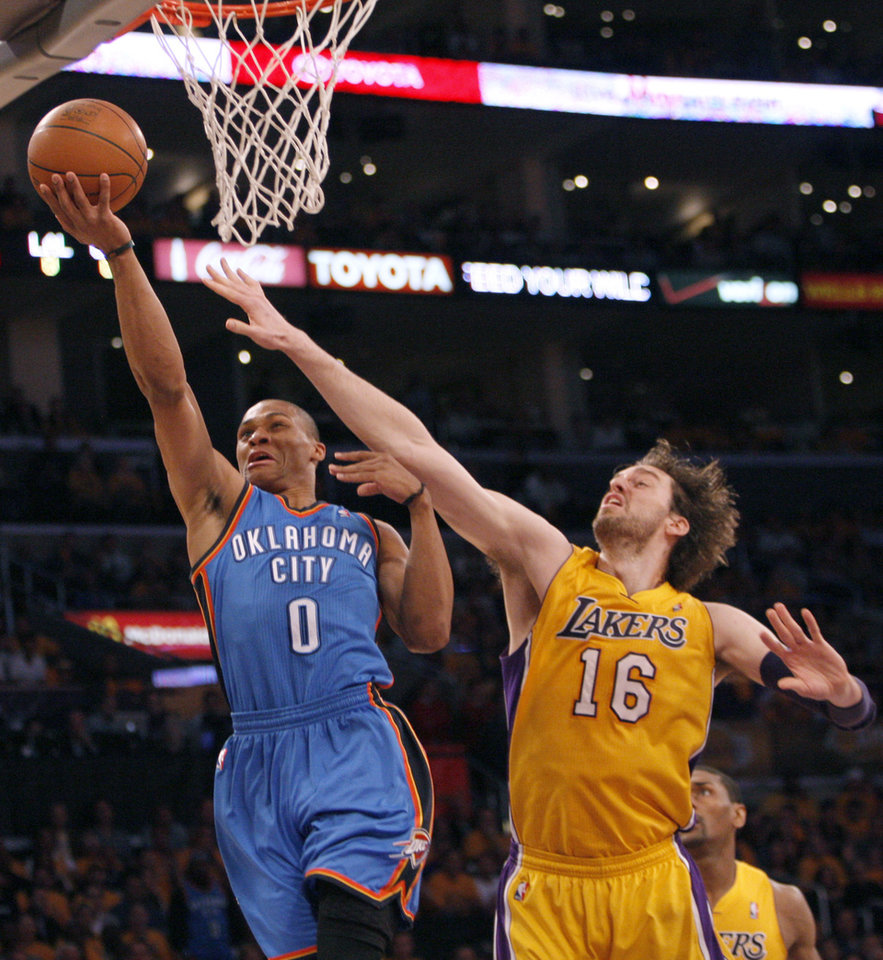 LOS ANGELES LAKERS: Oklahoma City\'s Russell Westbrook (0) shoots over Los Angeles\' Pau Gasol (16) during Game 3 in the second round of the NBA basketball playoffs between the L.A. Lakers and the Oklahoma City Thunder at the Staples Center in Los Angeles, Friday, May 18, 2012. Photo by Nate Billings, The Oklahoman