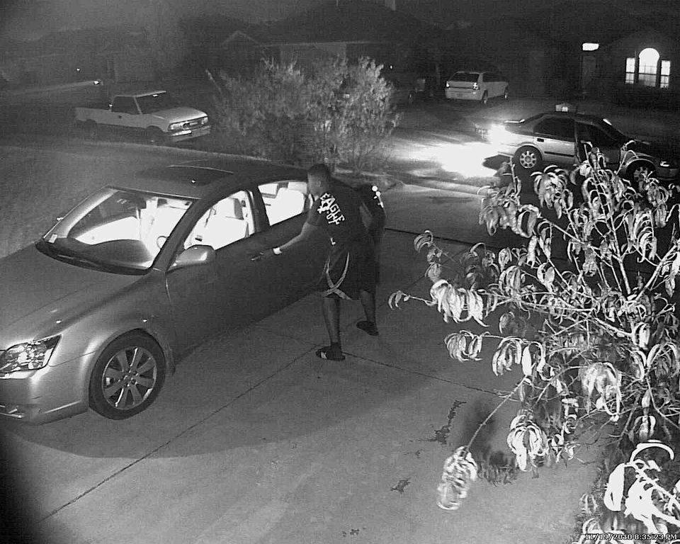 Photo - CAR BURGLARY / THEFT: On 11/19/2010 a woman parked her car in the driveway of 5009 SE 58th.  When she returned to it, she noticed that it had been burglarized.  The homeowner has a video surveillance system that captured an image of the suspect as he was burglarizing the vehicle (see attached photo).  The suspect vehicle is seen parked in the street in front of the residence.  Although you don't get a good look at the suspect's face, you get a very good look at his profile and the clothes he is wearing.  ORG XMIT: KOD