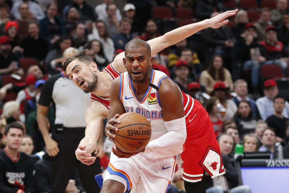 Photo - Oklahoma City Thunder's Chris Paul drives to the basket past Chicago Bulls' Tomas Satoransky during the first half of an NBA basketball game Tuesday, Feb. 25, 2020, in Chicago. (AP Photo/Charles Rex Arbogast)