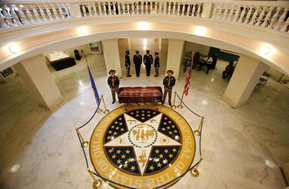 Photo -  Oklahoma civil rights leader  Clara Luper was honored by the state as her body lay in repose on the first floor of the state Capitol, Thursday, June 16, 2011. Her dark wood casket remained closed as a pair of Oklahoma Highway Patrol troopers stood silently on either side of the casket. Photo by Jim Beckel, The Oklahoman