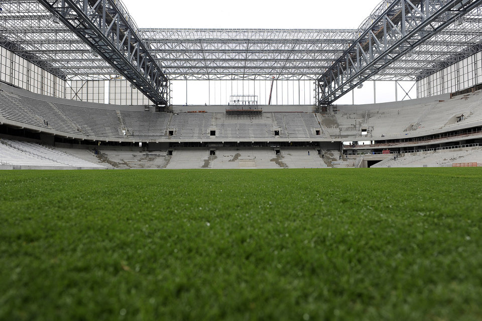 FILE - This Feb. 18, 2014 file photo shows a view of the Arena da Baixada from the field in Curitiba, Brazil. The southern Brazilian city will host matches during this year's World Cup. (AP Photo/Denis Ferreira Netto, File)